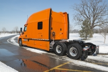 Bolt 150-inch Platinum Series Sleeper Orange Truck Passenger Back