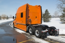 Bolt 150-inch Platinum Series Sleeper Orange Truck Back