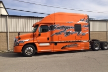 Bolt 150-inch Platinum Series Sleeper Orange Truck with Decals Drivers Side